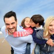 Foto Stock: Portrait of cheerful family at the beach