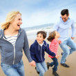 Stock Photo: Family running on the beach