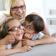Woman and children with eyeglasses on — Foto Stock