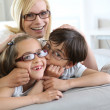 Woman and children with eyeglasses on — Stockfoto