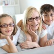 Woman and children with eyeglasses on — Stock Photo