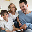 Children with daddy at home using digital tablet — Foto Stock