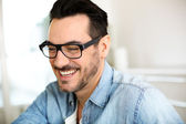Cheerful handsome trendy guy with glasses — Stock Photo