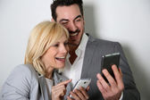 Couple using smartphone together — Stock Photo
