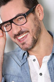 Portrait of smart guy with eyeglasses on — Stock Photo