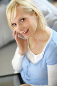 Portrait of blond girl talking on the phone — Stock Photo