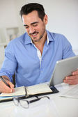 Smiling businessman working from home — Stock Photo