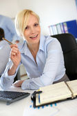 Portrait of businesswoman talking to client — Stock Photo