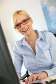 Portrait of smiling businesswoman with eyeglasses — Stock Photo