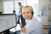 Portrait of beautiful customer service operator — Stock Photo