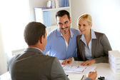 Couple meeting real-estate agent to buy property — Stock Photo