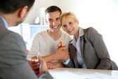 Happy couple getting keys of their new home — Stock Photo