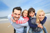 Portrait of cheerful family at the beach — Stock Photo