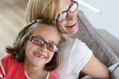 Mother and daughter with eyeglasses on — Stock Photo