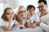 Family of four wearing eyeglasses — Stock Photo