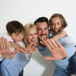 Family of four standing on white background — Stock Photo #27880035