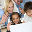 Family using webcamera to communicate with loved ones — Stock Photo