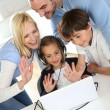 Family using webcamera to communicate with loved ones — Stock Photo #27880073
