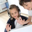 Portrait of kids waving at webcamera with laptop — Stock Photo #27880095