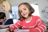 Portrait of beautiful little girl in class — Stock Photo