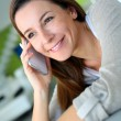 Cheerful brunette girl talking on mobile phone — Stock Photo