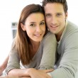 Portrait of cheerful couple standing at home — Stock Photo