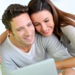 Cheerful couple websurfing on internet with tablet — Stock Photo #27916939