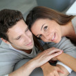 Stock Photo: Portrait of sweet couple sitting in sofa