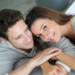 Stockfoto: Portrait of sweet couple sitting in sofa
