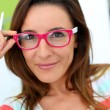 Stock Photo: Portrait of funny girl with pink eyeglasses on