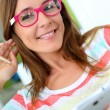 Portrait of funny girl with pink eyeglasses on — Stock Photo