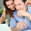 Couple at home looking at bank account on internet — Stock Photo
