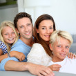 Portrait of family relaxing in sofa — Stock Photo #27917267