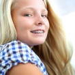 Stock Photo: Portrait of teenager with braces