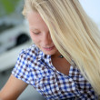Portrait of teenager using digital tablet — Stock Photo