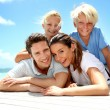 Foto Stock: Portrait of cheerful family on vacation in Caribe
