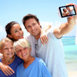 Couple and children taking family picture — Stock Photo