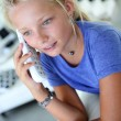 Teenaged girl talking on phone — Stock Photo #27917569
