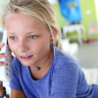 Teenaged girl talking on the phone — Stock Photo