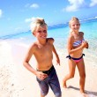 Stock Photo: Kids running on sandy beach in Caribe