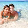 Portrait of cheerful couple in Caribbean sea — Stock Photo