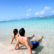 Couple relaxing in Carribean sea water — Stock Photo #27917805