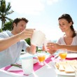 Stock Photo: Couple enjoying breakfast in resort