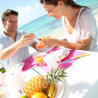 Couple enjoying breakfast in resort — Stockfoto