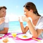 Couple enjoying breakfast in resort — Stock Photo #27917863