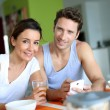 Couple having breakfast at home — Stock Photo