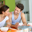Couple having breakfast at home — Stock Photo #27917913