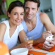 Couple having breakfast at home — Stock Photo #27917915