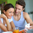 Couple having breakfast at home — Stock Photo #27917929