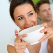 Portrait of young woman having breakfast — Stock Photo #27917971